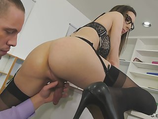 Nerdy transsexual office slut Melanie Brooks is microwave-ready with a nice blowjob