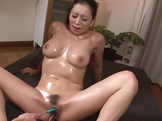 Busty Milf Enjoys Japan Cum Over Will not hear of Hairy Pussy