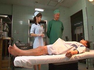 Japanese nurse Minami Kojima spreads her legs to be penetrated